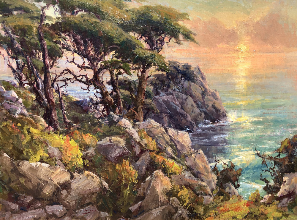 Cypress trees along the coast at sunset at Point Lobos in Carmel, California.