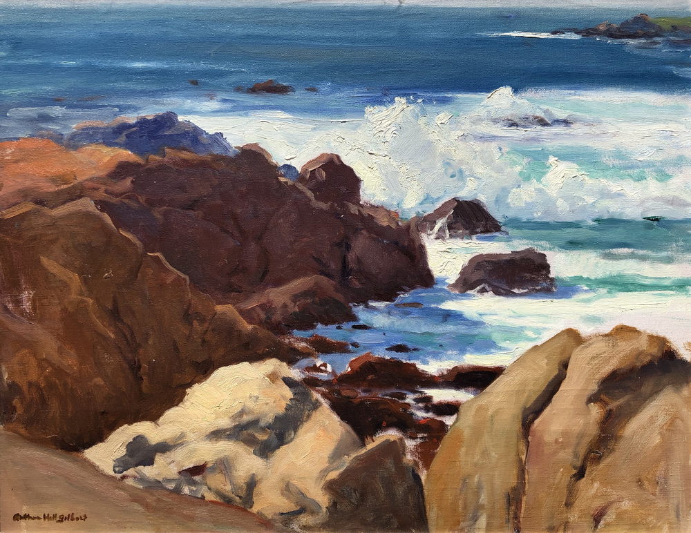 Rocks and waves in bright sunlight along the coast of Northern California