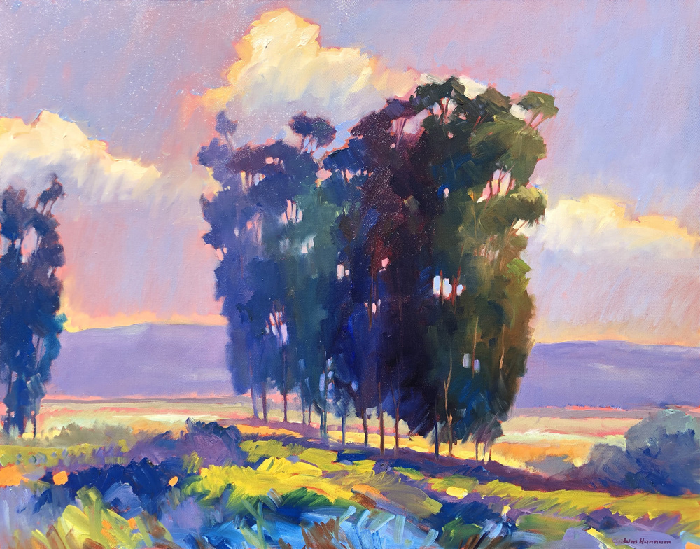 A colorful Expressionist landscape of backlit Eucalyptus trees with sunlit fields, hills in the distance, and a partly-cloudy sky.