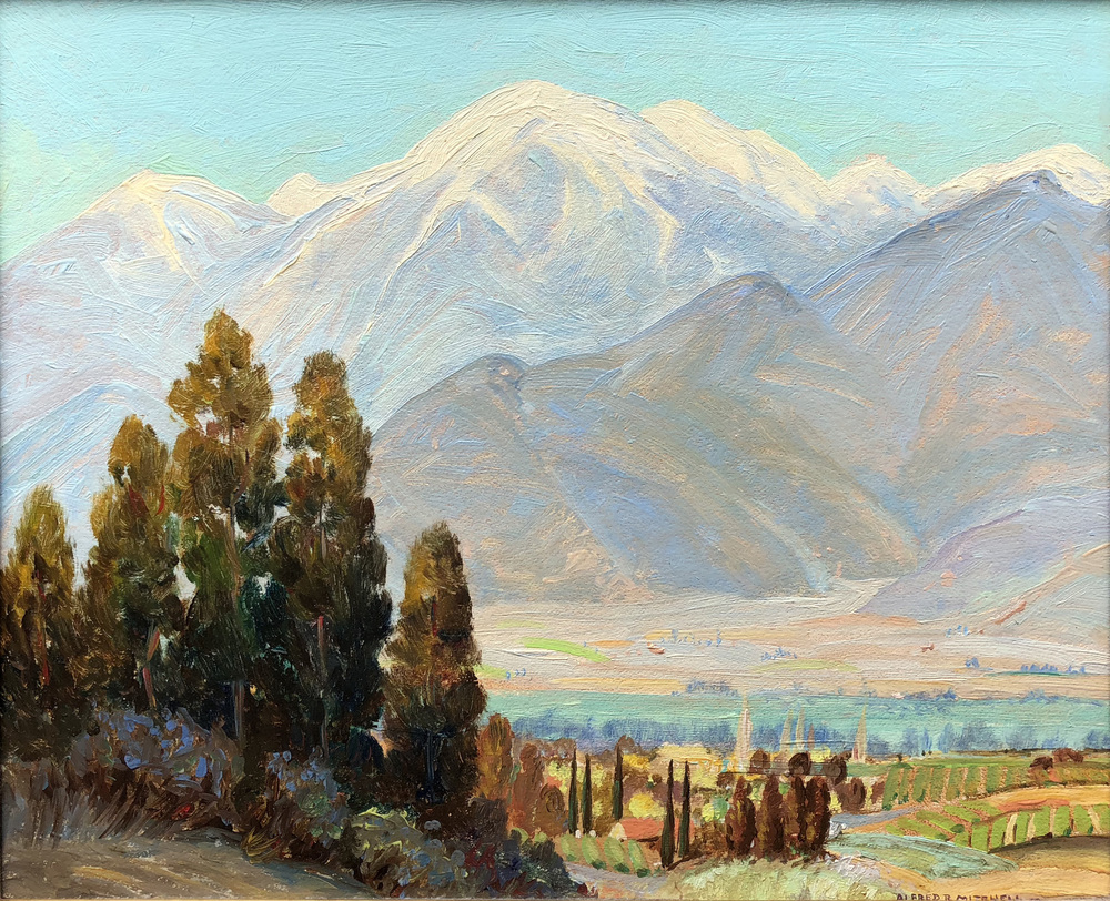A Southern California landscape painted near El Cajon, California, with trees, buildings and water in the foreground and snow-capped mountains rising in the distance.